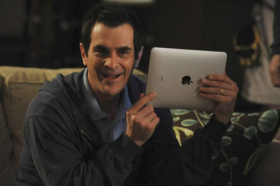 "In this publicity image released by ABC, Ty Burrell who portrays Phil Dunphy is shown with the Apple iPad in an episode of ""Modern Family, airing Wednesday, March 31, 2010. Photo: Eric McCandless, Associated Press"