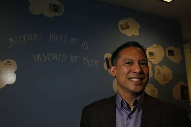 John Corpus, CEO of Milyoni, is seen in front of the inspiration wall at the Milyoni offices on Monday, April 30, 2012 in Pleasanton, Calif. Photo: Lea Suzuki, The Chronicle
