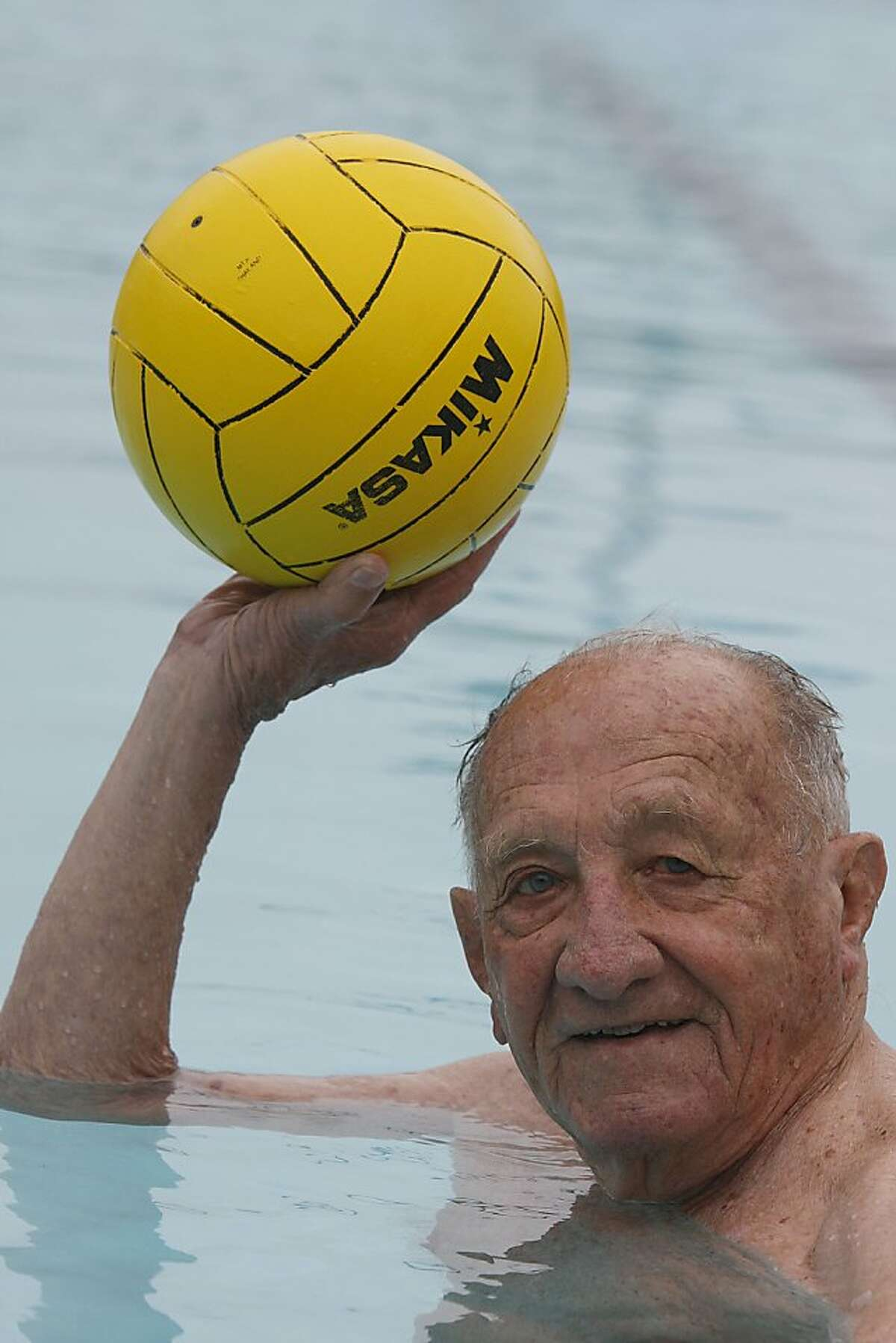 Alex Tarics, 98 years old, throws a ball during a morning swim at Belvedere Tennis Club in Tiburon, Calif., on Thursday, May 3, 2012. Alex is the oldest living olympic gold medalist. He won the medal playing water polo during the 1936 olympics .
