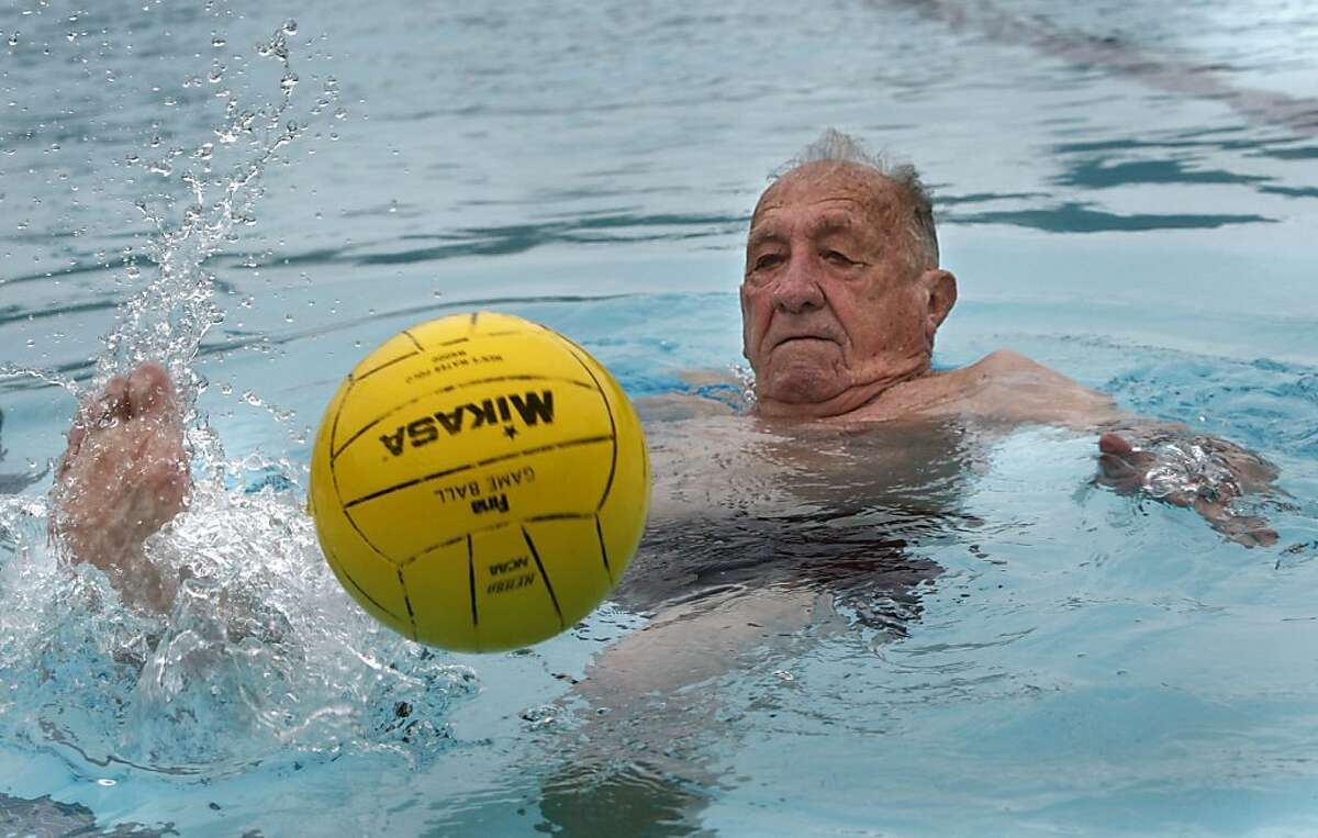 Alex Tarics, 98 years old, kicking the ball during a morning swim at Belvedere Tennis Club in Tiburon, Calif., on Thursday, May 3, 2012. Alex is the oldest living olympic gold medalist. He won the medal playing water polo during the 1936 olympics .