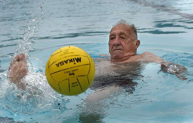 Alex Tarics, 98 years old, kicking the ball during a morning swim at Belvedere Tennis Club in Tiburon, Calif., on Thursday,  May 3, 2012.  Alex is the oldest living olympic gold medalist.  He won the medal playing water polo during the 1936 olympics . Photo: Liz Hafalia, The Chronicle