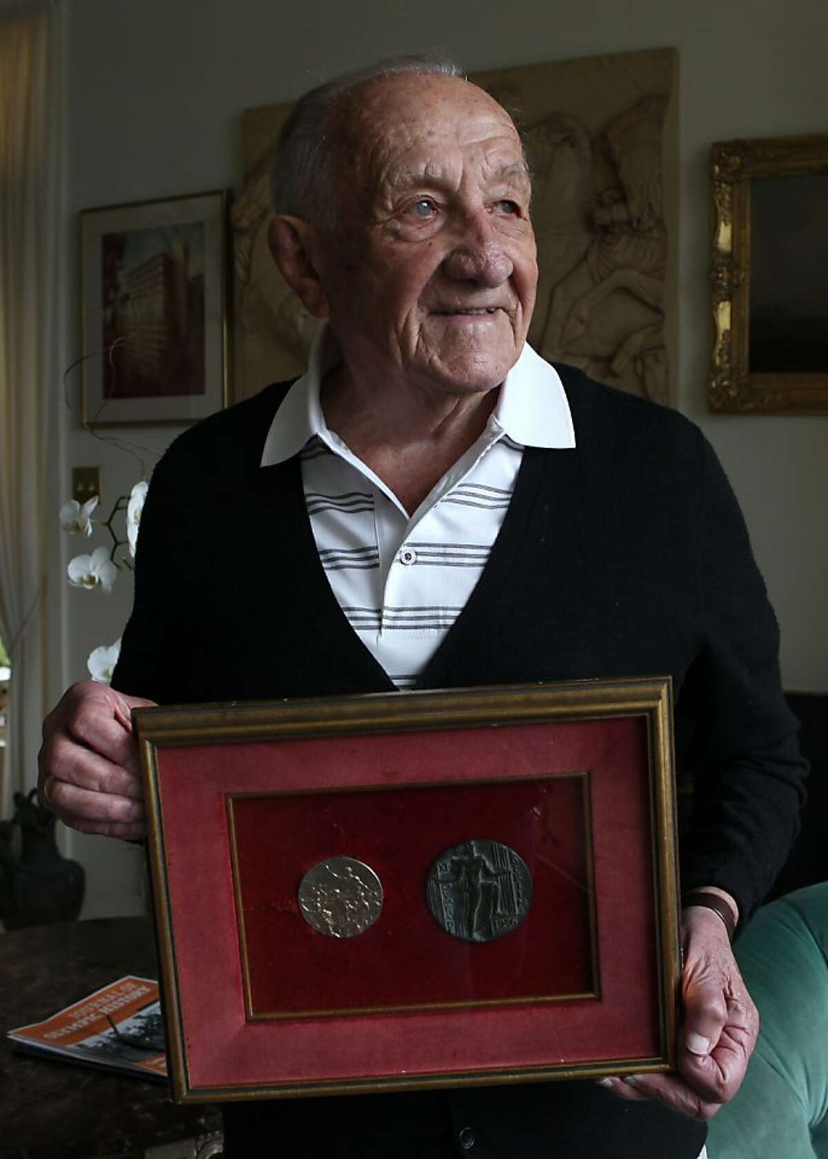 Alex Tarics, 98 years old, shows his gold medal (left) and medal (right, given to all 1936 Olympic participants) at home in Tiburon, Calif., on Thursday, May 3, 2012. Alex is the oldest living olympic gold medalist. He won the medal playing water polo during the 1936 olympics.