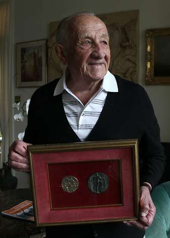 Alex Tarics, 98 years old, shows his gold medal (left) and medal (right, given to all 1936 Olympic participants) at home in Tiburon, Calif., on Thursday,  May 3, 2012.  Alex is the oldest living olympic gold medalist.  He won the medal playing water polo during the 1936 olympics. Photo: Liz Hafalia, The Chronicle