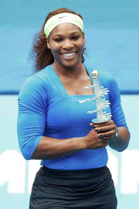Serena Williams from U.S. holds the trophy after defeating Victoria Azarenka from Belarus in their singles women's final tennis match at the Madrid Open tennis tournament in Madrid Sunday, May 13, 2012. (AP Photo/Daniel Ochoa de Olza) Photo: Daniel Ochoa De Olza / AP