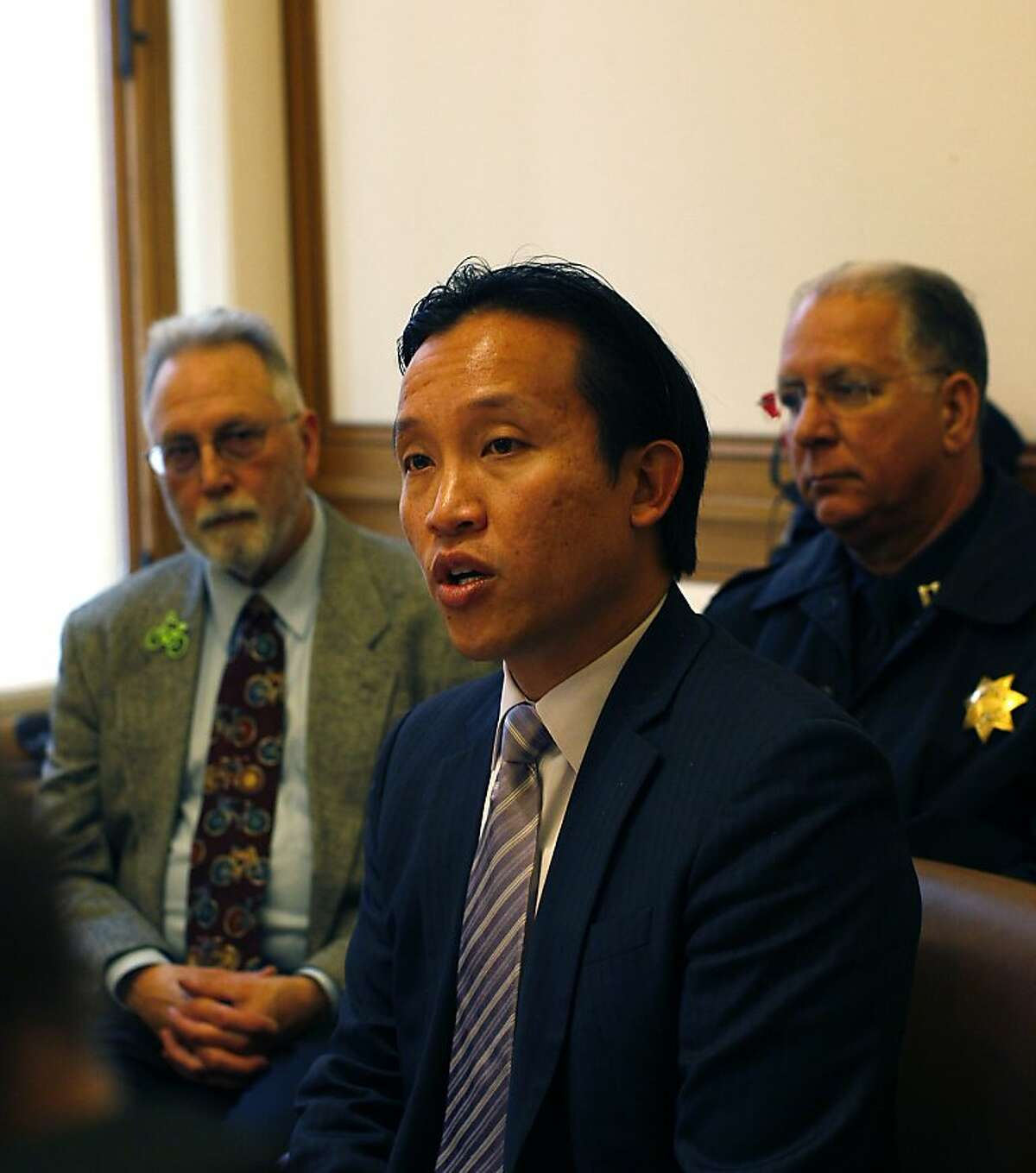 Board of Supervisors president David Chiu, center, with chair of the bicycle advisory committee Bert Hill, left, and Captain Al Casciato, of the SFPD, talks about San Francisco's New Street Safety Program at a meeting between partners of the program and the media at City Hall, San Francisco, Calif on April 10, 2012.