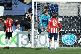 SANTA CLARA, CA - MAY 13: Alan Gordon #16 of the San Jose Earthquakes hits a header for a goal past Dan Kennedy #1 of the Chivas USA in the second half at Buck Shaw Stadium on May 13, 2012 in Santa Clara, California. The game ended in a 1 to 1 tie. (Photo by Thearon W. Henderson/Getty Images)