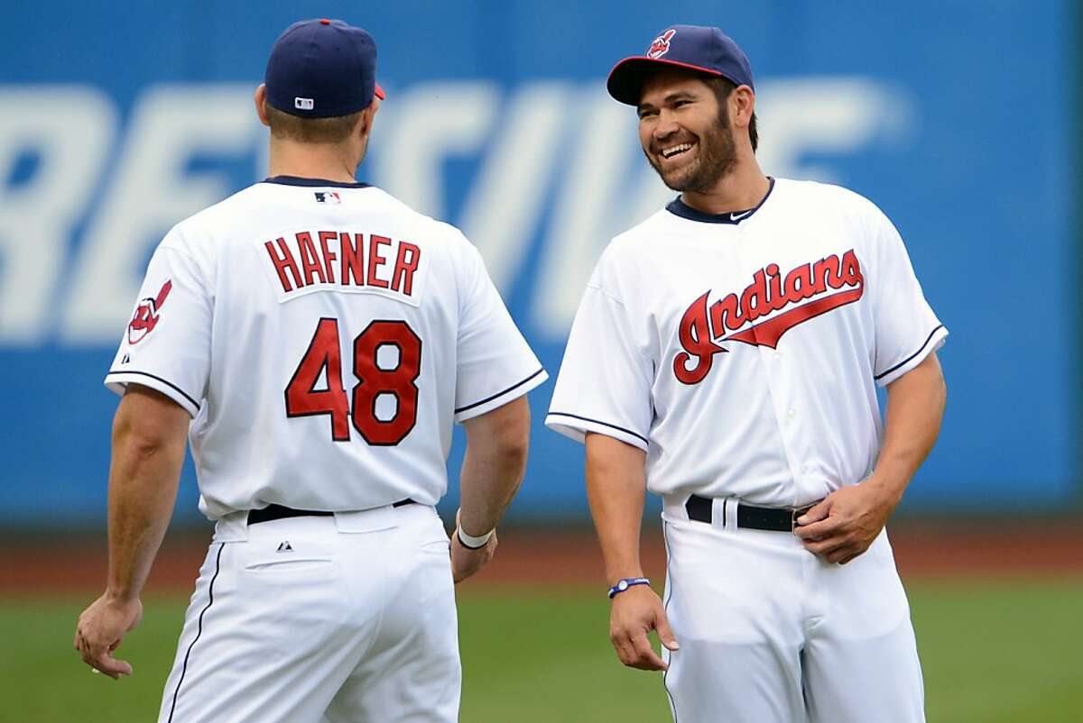 CLEVELAND, OH - MAY 4: Travis Hafner #48 talks with new teammate Johnny Damon #33 of the Cleveland Indians prior to the start of the game against the Texas Rangers at Progressive Field on May 4, 2012 in Cleveland, Ohio. (Photo by Jason Miller/Getty Images)