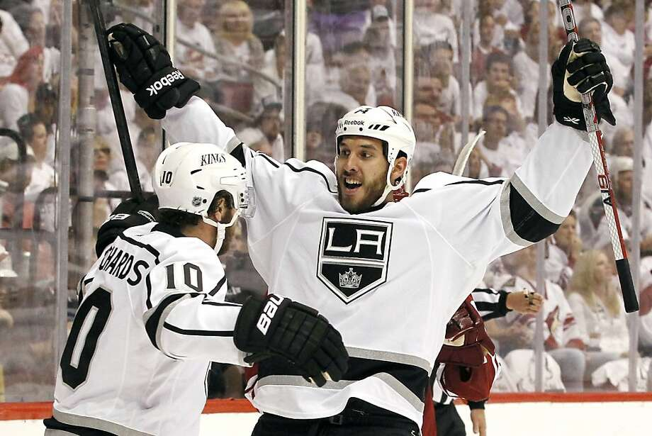Los Angeles Kings' Dwight King (74) celebrates his goal against the Phoenix Coyotes with teammate Mike Richards (10) during the second period of Game 1 of the NHL hockey Stanley Cup Western Conference finals, Sunday, May 13, 2012, in Glendale, Ariz.(AP Photo/Ross D. Franklin) Photo: Ross D. Franklin, Associated Press