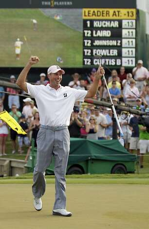 Matt Kuchar raises his hands on the 18th green after winning the Players Championship golf tournament at TPC Sawgrass, Sunday, May 13, 2012, in Ponte Vedra Beach, Fla. (AP Photo/Chris O'Meara) Photo: Chris O'Meara, Associated Press