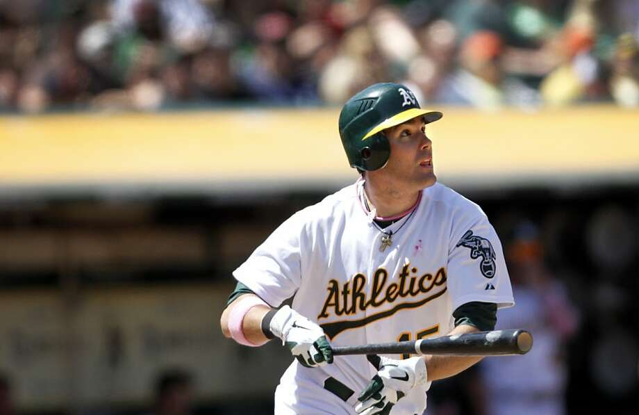 The Oakland A's Seth Smith watches his home run in the fifth inning of their game against the Detroit Tigers in Oakland, Calif., Sunday, May 13, 2012.  The A's lost 3-1. Photo: Sarah Rice, Special To The Chronicle