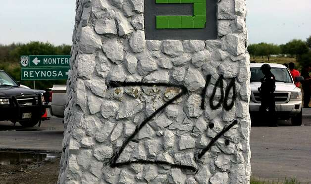 A graffiti (Zeta 100%) was painted in the place where 49 corpses were found on the Monterrey-Reynosa road, Mexico, in the border with the USA, on May 13, 2012. At least 49 mutilated bodies were found on a road in the north of Mexico, surrounding the metropolitan area of Monterrey, the third most populated in the country, the State Prosecutor's Office reported . AFP PHOTO/JULIO CESAR AGUILARJulio Cesar Aguilar/AFP/GettyImages Photo: Julio Cesar Aguilar, AFP/Getty Images