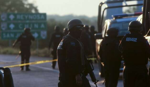 Mexican Federal personnel police block the road between the cities of Monterrey and Reynosa, Mexico, (in the border with the USA), on May 13, 2012. At least 37 mutilated bodies were found the road in the North of Mexico, surrounding the metropolitan area of Monterrey, the third most populated in the country, the State Prosecutor's Office reported . AFP PHOTO/JULIO CESAR AGUILARJulio Cesar Aguilar/AFP/GettyImages Photo: Julio Cesar Aguilar, AFP/Getty Images