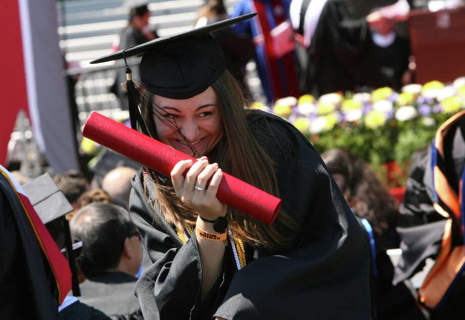 Laura Harsche, of Bethel, graduates from Sacred Heart University in Fairfield, Conn. on Sunday, May 13, 2012. Photo: B.K. Angeletti / Connecticut Post