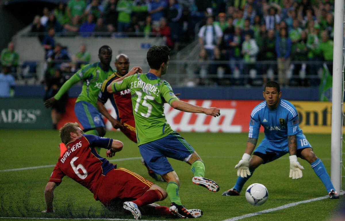 Real Salt Lake goalie, Nick Rimando, lines up to block a shot by Seattle's Alvaro Fernandez during the Seattle Sounders vs. Real Salt Lake match on Saturday, May 12, 2012. The Sounders lost 0-1.