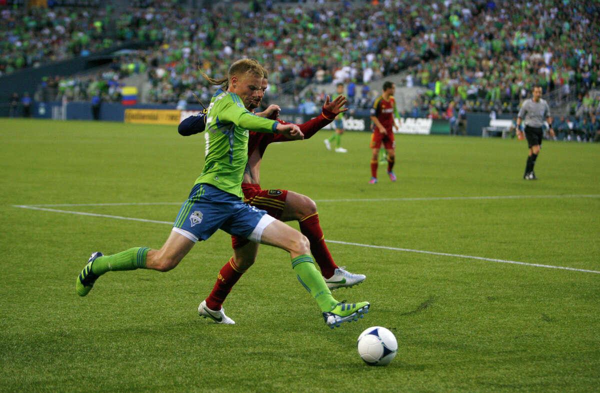 Seattle's midfielder, Christian Sivebaek races Real Salt Lake player Kyle Beckerman.
