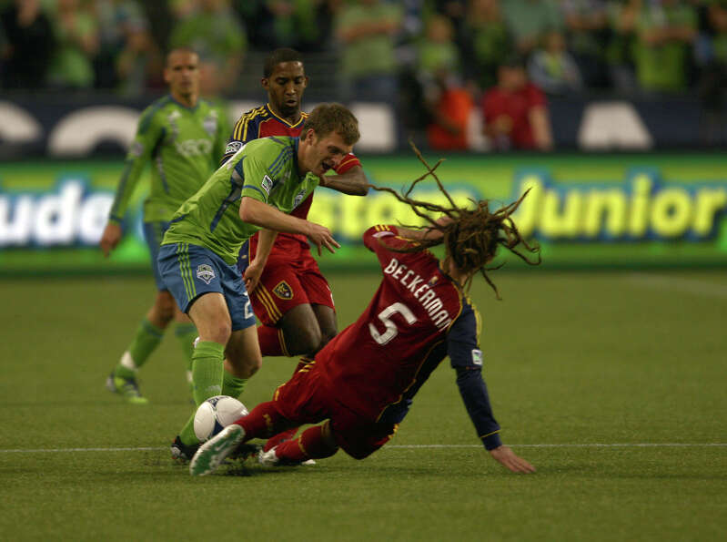 Real Salt Lake midfielder Kyle Beckerman attempts to steal the ball from Seattle's Christian Sivebae