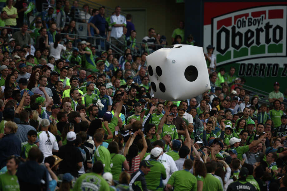Fans toss around giant dice during the game. Photo: SOFIA JARAMILLO / SEATTLEPI.COM