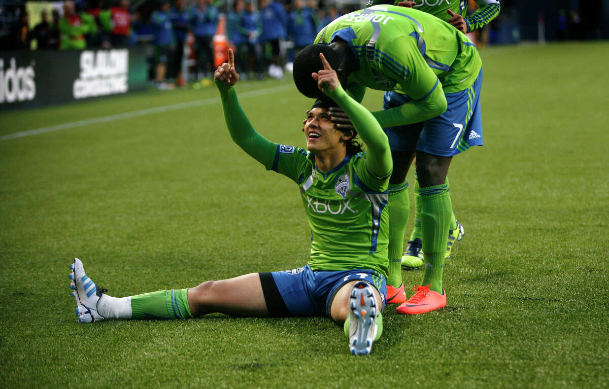 Seattle Sounders player Fredy Montero celebrates with teammate Eddie Johnson, 7, after Montero scored his first goal of the season against the Los Angeles Galaxy on Wednesday, May 2, 2012 at CenturyLink Field in Seattle. Johnson scored a goal earlier in the game.