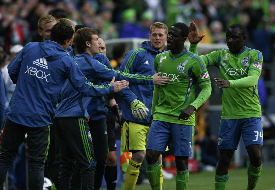 Eddie Johnson is congratulated by teammates after scoring the first goal of the Sounders vs. Galaxy game. Photo: SOFIA JARAMILLO / SEATTLEPI.COM