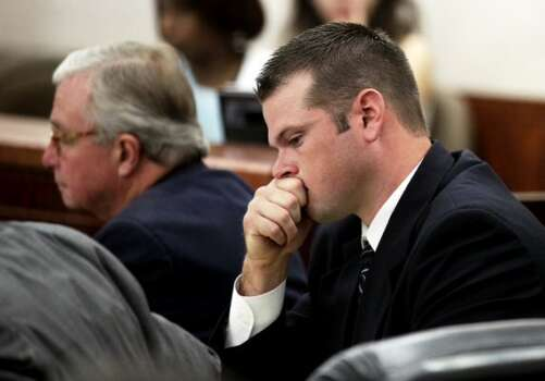 Former Houston police officer Andrew Blomberg sits in the courtroom Monday, May 14, 2012, in Houston. Blomberg is on trial for official oppression in the video taped 2010 beating of 15-year-old Chad Holley. ( Brett Coomer / Houston Chronicle )