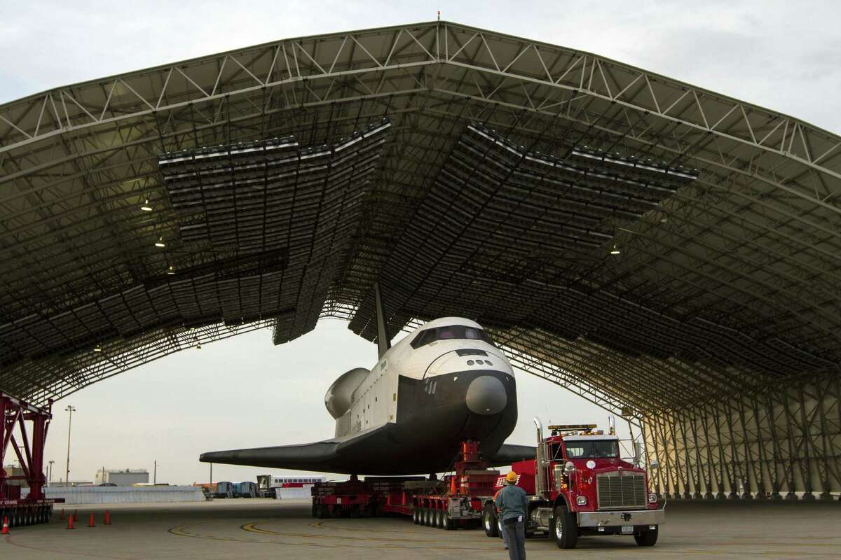 TOPSHOTS The US space shuttle Enterprise, mounted on transport vehicle, is backed into a temporary hanger after being demated from the NASA 747 Shuttle Carrier Aircraft (SCA) at John F. Kennedy (JFK) International Airport in Jamaica, New York, Sunday, May 13, 2012. Enterprise will be placed on a barge that will move by tugboat up the Hudson River to the Intrepid Sea, Air & Space Museum in June. The shuttle will be lifted by crane and placed on the flight deck of the Intrepid, where it will be on exhibit to the public starting this summer in a temporary climate-controlled pavilion. AFP PHOTO / NASA / Kim SHIFLET == RESTRICTED TO EDITORIAL USE / MANDATORY CREDIT: