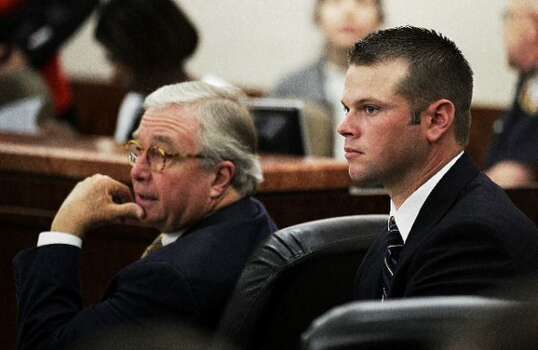 Defense attorney Dick DeGuerin, left, sits with his client, former Houston police officer Andrew Blomberg, during the trial against Blomberg Monday, May 14, 2012, in Houston. Blomberg is on trial for official oppression in the video taped 2010 beating of 15-year-old Chad Holley. ( Brett Coomer / Houston Chronicle )