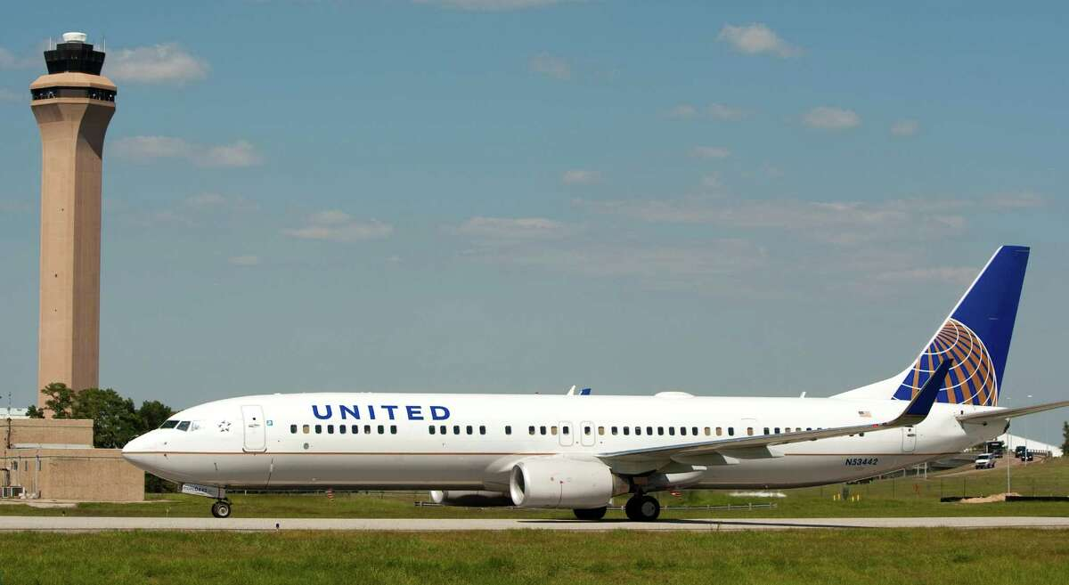 Continental Airlines flight 747 taxies toward the terminal after landing at George Bush Intercontinental Airport painted the new United Airlines paint scheme Friday, Oct. 1, 2010, in Houston. Continental and United officially merged Friday. ( Brett Coomer / Houston Chronicle )