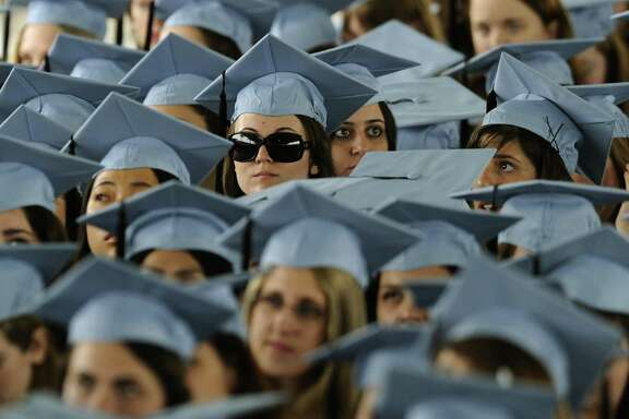 Graduates listen to US President Barack Obama as he delivers the Commencement Address at Barnard College's graduation ceremony in New York on May 14, 2012.   AFP PHOTO/TIMOTHY A. CLARYTIMOTHY A. CLARY/AFP/GettyImages