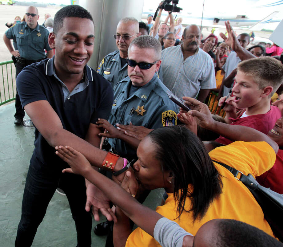 """American Idol"" finalist Joshua Ledet of Westlake, La., is greeted by fans after his arrival from Los Angeles at Chennault International Airport in Lake Charles on Friday, May 11, 2012. Ledet, the 20-year-old top-three finalist on Fox's TV singing competition will be honored with a parade in his home town on Saturday, May 12, 2012, and a pep rally in Burton Coliseum in Lake Charles that evening. (AP Photo/K Wink, LAKE CHARLES AMERICAN PRESS) Photo: K Wink, MBO"