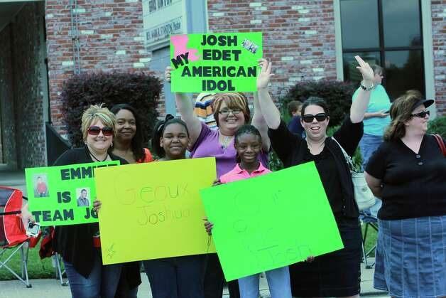 "Fans of ""American Idol"" contestant Joshua Ledet line the streets for a parade held in his honor, Saturday, May 12, 2012 in Westlake, La. Southwest Louisiana has American Idol fever thanks to Westlake native Joshua Ledet's signature gospel voice propelling him into the Fox TV singing competition's Top 3. (AP Photo/The American Press, Michelle Higginbotham) MANDATORY CREDIT Photo: Michelle Higginbotham, MBO"