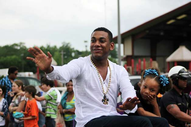 Joshua Ledet and family members roll down the streets for a parade held in his honor, Saturday, May 12, 2012 in Westlake, La. Southwest Louisiana has American Idol fever thanks to Westlake native Joshua Ledet's signature gospel voice propelling him into the Fox TV singing competition's Top 3. (AP Photo/The American Press, Michelle Higginbotham) MANDATORY CREDIT Photo: Michelle Higginbotham, MBO