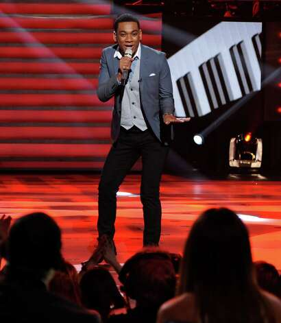 "In this March 7, 2012 photo released by Fox, contestant Josh Ledet, 19, of Westlake, La., performs on the singing competition series ""American Idol,"" in Los Angeles.  On the Fox show's 400th episode, the men tackled songs from Stevie Wonder's catalogue and the women choose from Whitney Houston's hits, a tribute to the singer who died Feb. 11, on the eve of the Grammy Awards, at age 48. (AP Photo/Fox, Michael Becker) Photo: Michael Becker, HONS"