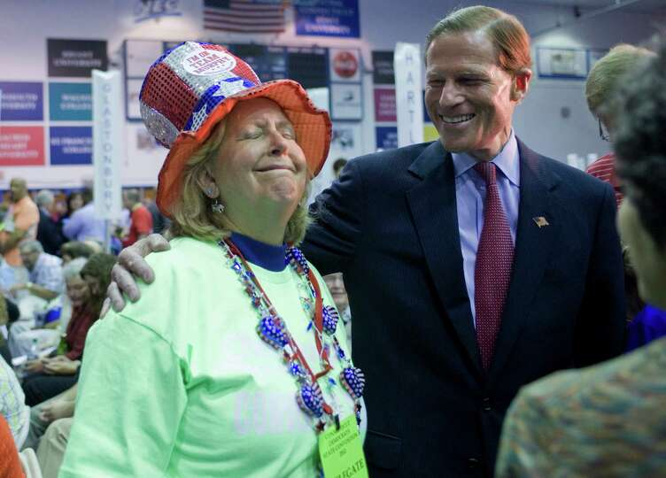 U.S. Senator Richard Blumenthal, D-Conn., right, talks with delegate Audrey Blondin of Litchfield at