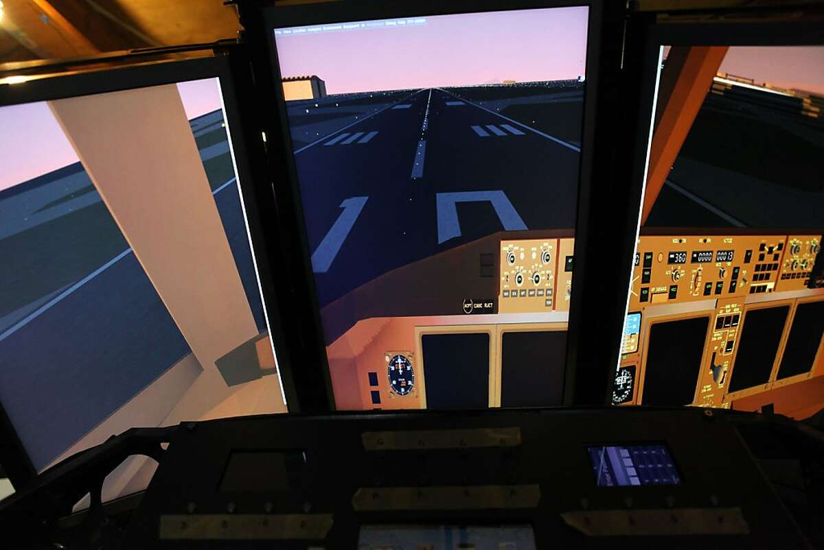 The flight simulator showing three screens from the cockpit in San Rafael, Calif., on Wednesday, May 9, 2012.