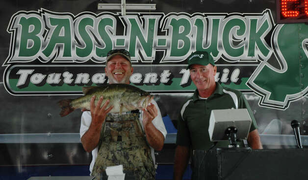 Andy Williams caught the biggest bass of the tournament, weighing in at 8.75 lbs.  It anchored a 7th place overall finish for him and his brother Malcolm with a total 20.83 lb stringer.  photo by Patty Lenderman / Lakecaster