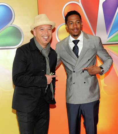 "Howie Mandel, left, and Nick Cannon from ""America's Got Talent"" arrive for the NBC network upfront presentation at Radio City Music Hall, Monday, May 14, 2012 in New York. (AP Photo/Evan Agostini) Photo: Evan Agostini, Associated Press / AGOEV"