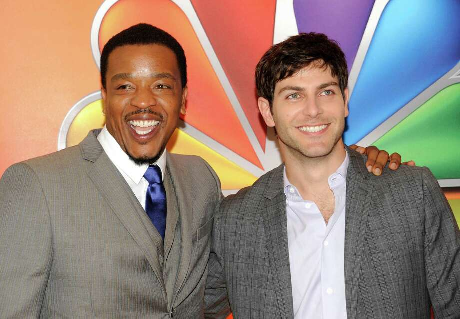 """Grimm"" cast members Russell Hornsby, left, and David Giuntoli arrive for the NBC network upfront presentation at Radio City Music Hall, Monday, May 14, 2012 in New York. (AP Photo/Evan Agostini) Photo: Evan Agostini, Associated Press / AGOEV"