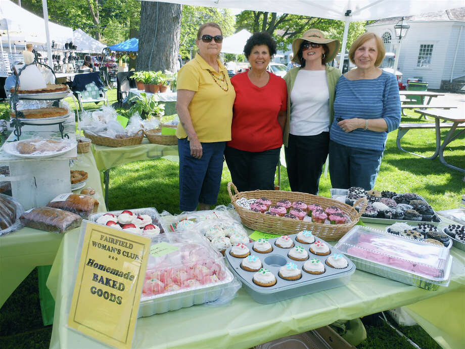 Organizers of the Fairfield Women's Club Arts & Crafts Market on Town Hall Green Saturday are, from left, Barbara Gomperts, Corinne Dellaera, Betty Walsh and Edie Szabo. Photo: Mike Lauterborn / Fairfield Citizen contributed