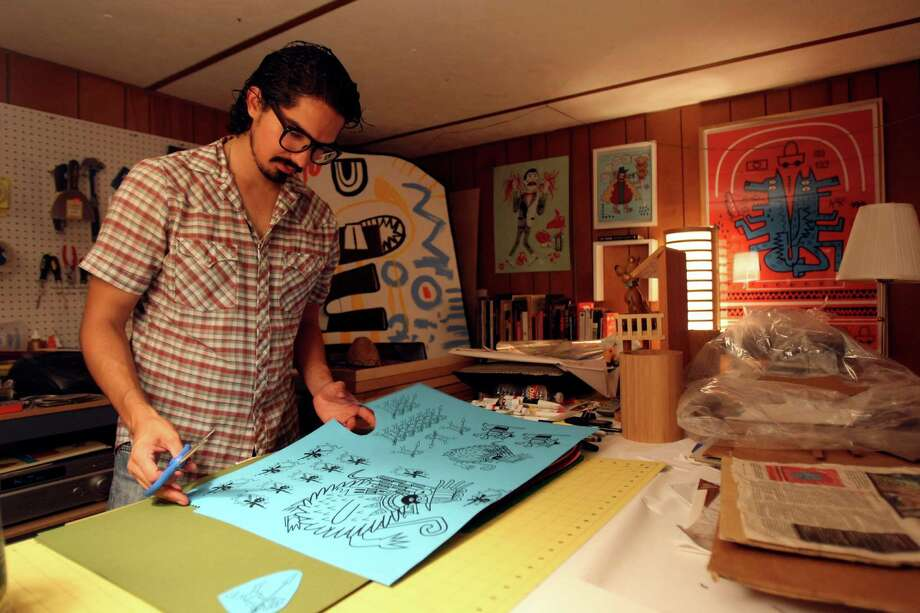 CONEXION:  Michael Menchaca is a visual artist whose work focuses on screen prints and digital images. Much of his work is focused on immigration issues and incorporates Aztec and Incan symbols.  Helen L. Montoya/Conexion Photo: HELEN L. MONTOYA, SAN ANTONIO EXPRESS-NEWS / ©2012 HELEN MONTOYA PHOTOGRAPHY
