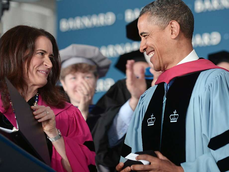 "US President Barack Obama smiles after he was presented with the 2012 Barnard Medal of Distinction by Barnard College President  Debora Spar during commencement ceremonies at Barnard College May 14, 2012 in New York City. Obama was in New York  to speak at the Barnard College commencement, to appear for an interview on ""The View"" and to attend a campaign fundraiser. AFP PHOTO/Mandel NGANMANDEL NGAN/AFP/GettyImages Photo: Mandel Ngan, AFP/Getty Images"