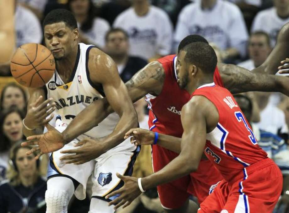 Point guard matchup: Clippers (3) Chris Paul (6-0, 7th yr): Considered the gold-standard of NBA point guards, notched 20.4 points, 7.1 assists, 5.7 rebounds in first round vs. Memphis. ... Led NBA in steals (152). ... Finished third in MVP balloting. ... Averaged 22 points, 8.7 assists vs. Spurs this season. Pictured: Los Angeles Clippers guard Chris Paul, right, and center DeAndre Jordan battle with Memphis Grizzlies forward Rudy Gay for the ball in the first half of Game 7 in a first-round NBA basketball playoff series on Sunday, May 13, 2012, in Memphis, Tenn.  (AP)