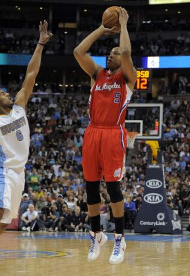 Small forward matchup: Clippers (5) Caron Butler (6-7, 10th yr): Once considered one of NBA's most explosive scorers, his average sank to 12 points in first season with Clippers. ... Went 16 of 43 in final five games of Memphis series after breaking left hand. ... Only Clipper with title ring, though injured for Dallas' run. Pictured: Los Angeles Clippers forward Caron Butler (5) shoots a three-point basket against Denver Nuggets guard Arron Afflalo (6) during the third quarter of an NBA basketball game on Wednesday, April 18, 2012, in Denver. (AP)
