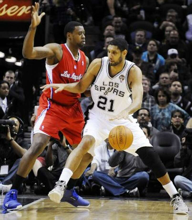 Center matchup: Clippers (6) DeAndre Jordan (6-11, 4th yr): Ex-Texas A&M standout, unpolished but wildly athletic. ... Capable rim-defender, averaging 2.0 blocks in season. ... Lacks skills to be complete offensive player. ... Often gives way to other big men (Kenyon Martin, Reggie Evans) in fourth quarter. Pictured: Los Angeles Clippers' DeAndre Jordan defends San Antonio Spurs' Tim Duncan (21) during the first half of an NBA basketball game, Friday, March 9, 2012, in San Antonio.  (AP)
