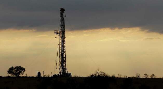 A drilling rig is seen near Kennedy a year ago.  A UTSA report says South Texas' Eagle Ford Shale oil and gas bonanza generated a $25 billion economic windfall,  creating nearly 48,000 jobs last year. Photo: File Photo, Associated Press / Copyright 2012 The Associated Press. All rights reserved. This material may not be published, broadcast, rewritten or redistribu