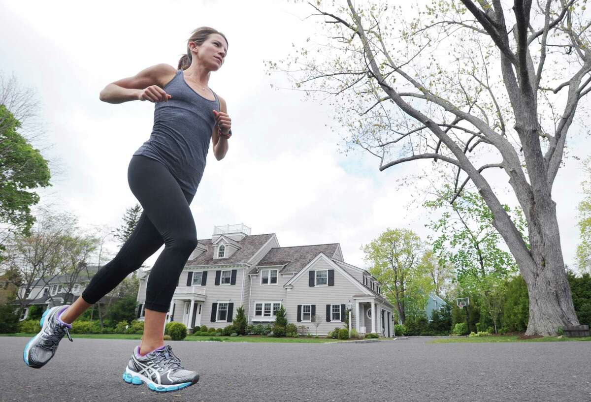 Long distance runner Mandy DiMarzo, 31, trains in her Old Greenwich neighborhood, Friday afternoon, April 20, 2012. DiMarzo has osteopenia, a precursor to osteoporosis that can affect active people whose calorie/food intake is not enough for the energy they are outputting.