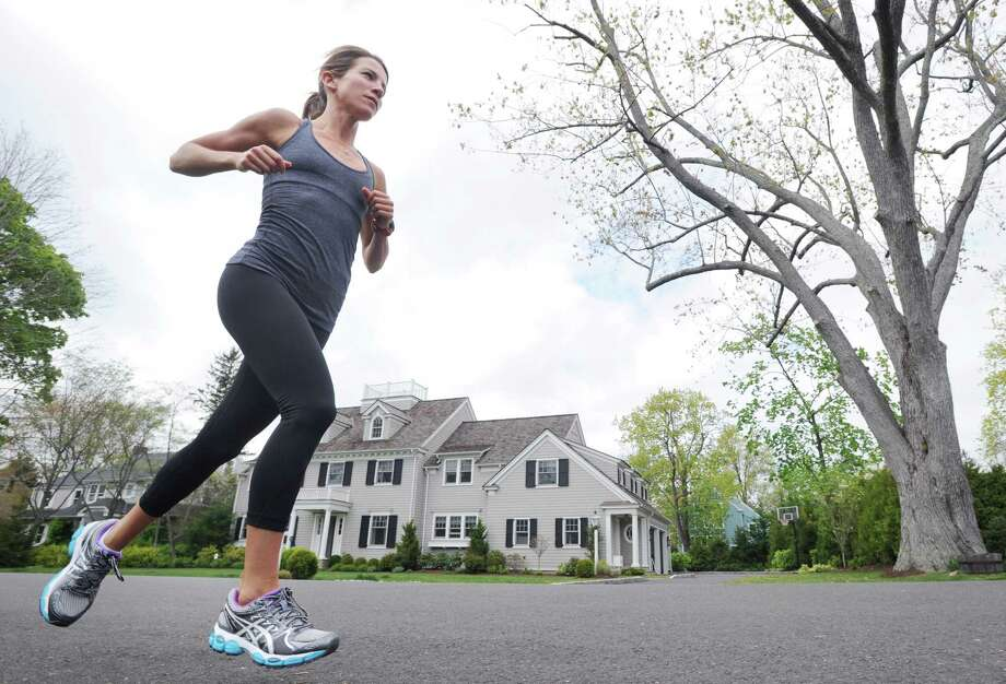 Long distance runner Mandy DiMarzo, 31, trains in her Old Greenwich neighborhood, Friday afternoon, April 20, 2012. DiMarzo has osteopenia, a precursor to osteoporosis that can affect active people whose calorie/food intake is not enough for the energy they are outputting. Photo: Bob Luckey / Greenwich Time