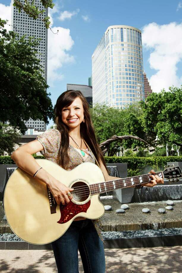 Houston native country singer Savannah Berry poses for a photo at Market Square Park, Thursday, May 3, 2012, in Houston.  Berry started uploading videos to YouTube in the sixth grade, mostly just to see what would happen. Today, at 17, her country covers and originals have more than 3.2 million total views and 14,000 plus subscribers. That viral power led to her being invited by the Academy of Country Music and Dick Clark Productions to perform a duet with duo Sugarland.    ( Michael Paulsen / Houston Chronicle ) Photo: Michael Paulsen / © 2012 Houston Chronicle