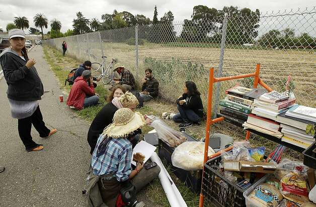 Protestors regroup after being evicted from a makeshift farm Monday, May 14, 2012, in Albany, Calif. Anti-development protesters who had planted an urban farm and camped on UC Berkeley-owned land were raided by UC Berkeley police early this morning after a deadline passed for them to vacate the property. (AP Photo/Ben Margot) Photo: Ben Margot, Associated Press