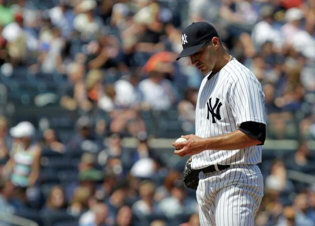 New York Yankees starting pitcher Andy Pettitte looks at the ball after Seattle Mariners' Casper Wells hit a home run during the sixth inning of a baseball game at Yankee Stadium in New York, Sunday, May 13, 2012.  (AP Photo/Seth Wenig) Photo: Seth Wenig