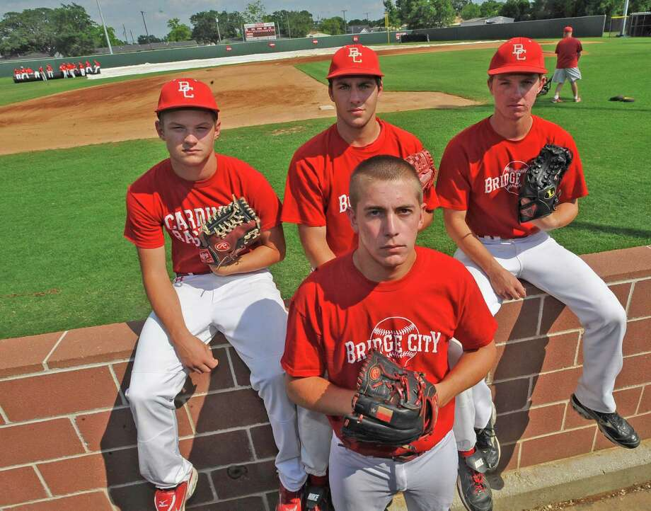 The Bridge City High School baseball team is led by an outstanding pitching staff. These four pitchers, Chase Shugart, back left, Hayden Guidry, Zach Smith, right, and Jake Lemoine, front, have an earned run average under 1. The team did not give up a single run in its playoff series last week. The leading pitcher, Jake Lemoine, threw a no-hitter on Friday. The staff has celebrated two no-hitters this season.  Dave Ryan/The Enterprise Photo: Dave Ryan